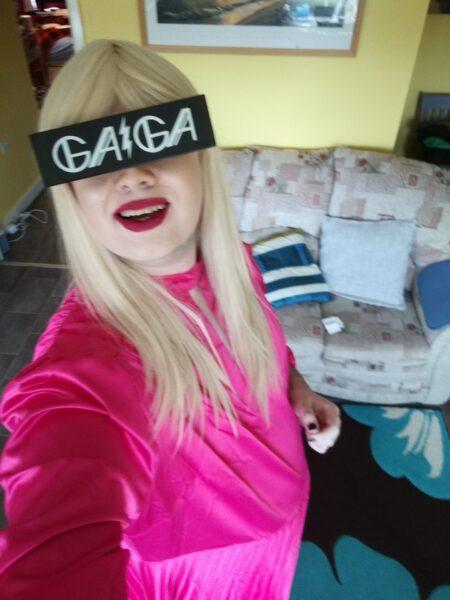 Gerraint dressed as Lady Gaga in a blonde wig and black Gaga glasses.